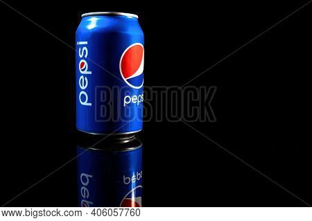 Rivne, Ukraine - February 1, 2021: Pepsi Can Close Up. A Can Of Chilled Pepsi-cola On A Black Backgr