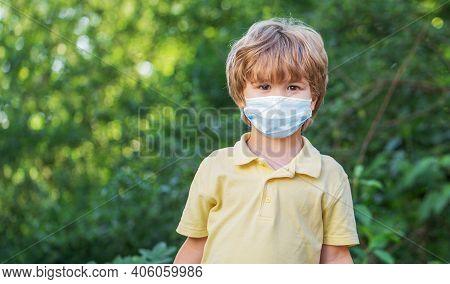 Boy Wearing Anti Virus Mask. Little Boy Wearing A Mask To Protect Him Against Corona Virus Covid-19.