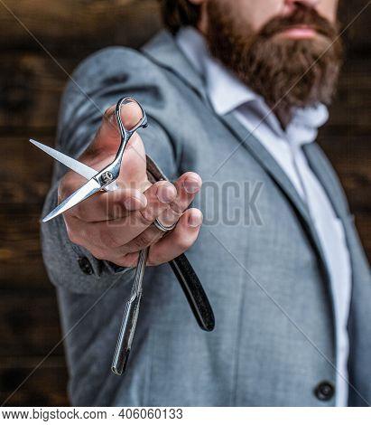 Vintage Barbershop. Brutal Guy, Scissors, Straight Razor. Bearded Client Visiting Barber Shop. Barbe