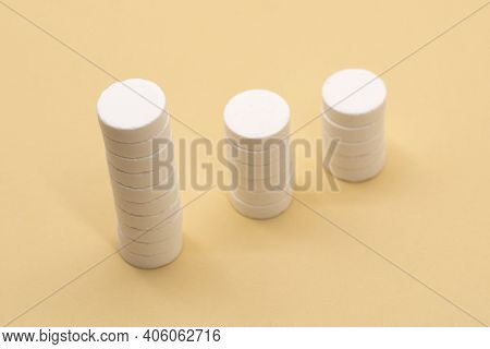 A Stack Of Pills On A Beige Background. Growth Graph Made Of Stacked White Pills - Growing Market An