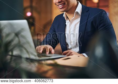 Joyous Male Telecommuter Working On His Computer