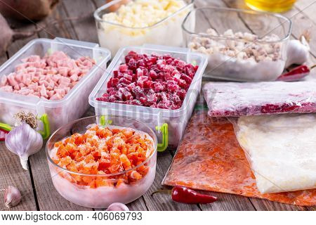 Frozen Food In Containers And Bags On The Table. Frozen Vegetables. Food Supplies For The Winter.