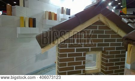 St. Petersburg, Russia - September 2020: Brick House Layout And Samples Of Bricks And Clinker At Exh