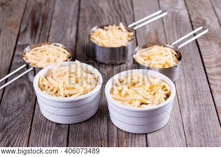 French Dish Julienne. Mushroom, Chicken And Cheese Gratin In Ceramic Bowls, On Wooden Table