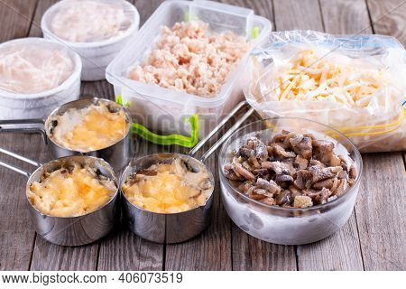 Frozen Food. French Dish Julienne. Mushroom, Chicken And Cheese Gratin In Bowls On Wooden Table