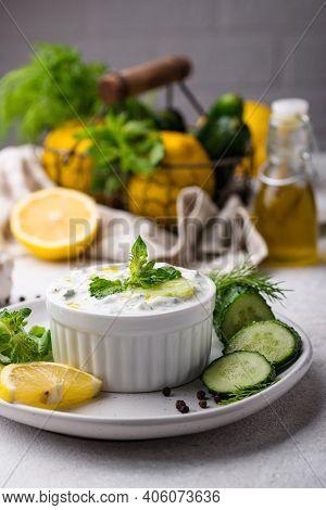 Traditional Greek Sauce Or Appetizer Tzatziki With Yogurt, Garlic, Cucumber And Dil