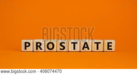 Prostate Symbol. Wooden Cubes With Word 'prostate'. Beautiful Orange Background. Medical And Prostat