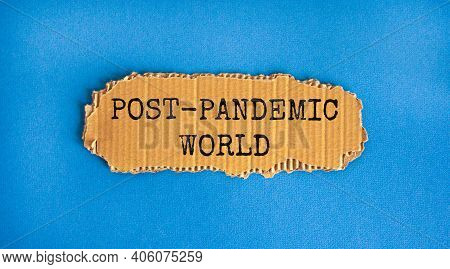 Post-pandemic World Symbol. Concept Words 'post-pandemic World' On Cardboard. Beautiful Blue Backgro