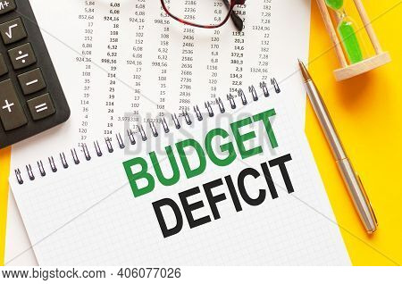 Writing Text Showing Budget Deficit. Writing Text Budget Deficit On White Paper Card, Green And Blac
