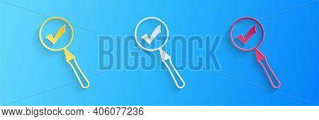 Paper Cut Magnifying Glass And Check Mark Icon Isolated On Blue Background. Magnifying Glass And App