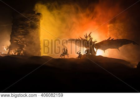 Battle Between Dragon And Heroic Soldiers. Creative Table Decoration. Selective Focus