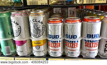 Cans Of Bud Light Seltzer And White Claw Alcohol Beverages In A Refriderator Case At A Wawa Store.