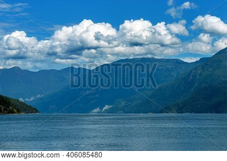 Clouds Roll Over The Mountains Near Earl's Cove, Bc. Earl's Cove Is A Bc Ferry Terminal On The Sunsh