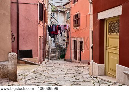 Rovinj, Istria, Croatia: Picturesque Old Alley With Ancient Houses In The Medieval Town