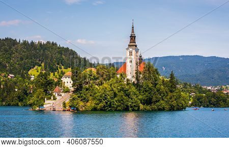 Famous Catholic Church On Island In The Middle Of Bled Lake With Tourists And Boats In Bled, Sloveni