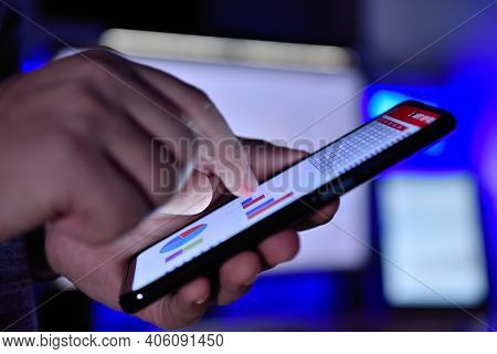 Businessman Hands Checks Business Report On Cellphone. Business And Financial Success Concept. Close