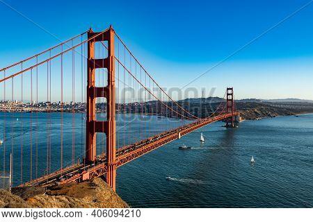 San Francisco, Usa - November 2017: Golden Gate Bridge And A Big Barge Floats Under It.