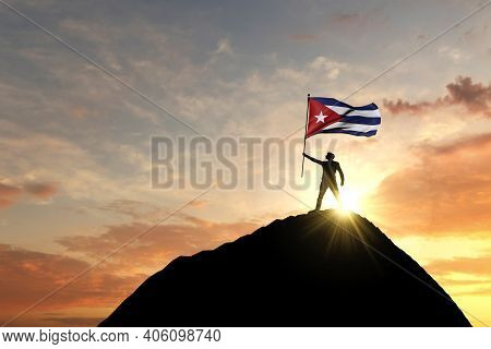 Cuban Flag Being Waved At The Top Of A Mountain Summit. 3d Rendering