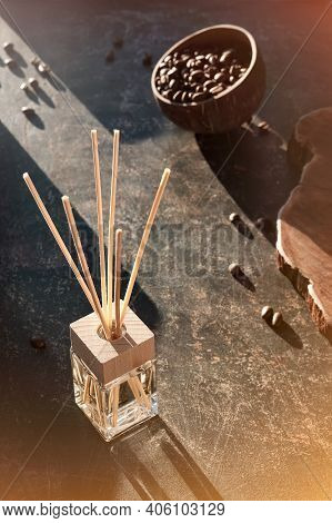 Air Freshener With Bamboo Sticks With Perfume In Glass On Dark Textured Background.invigorating Coff