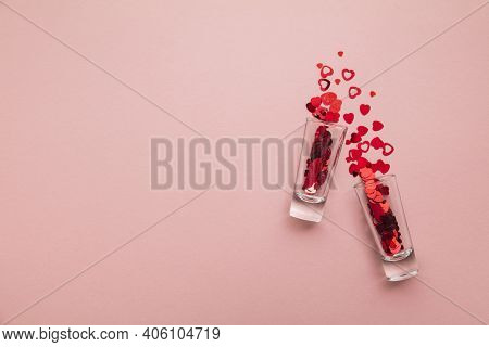 Valentines Day Shots. Shot Glass With Heart Confetti On Pastel Pink Background