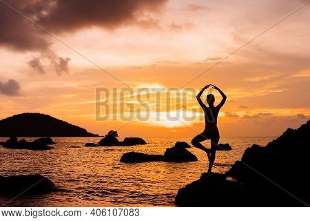Silhouette Of Woman Anainst Sunset On The Sea