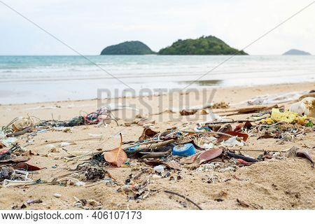 Spilled Garbage On The Beach. Empty Used Dirty Plastic Bottles. Environmental Pollution. Ecological