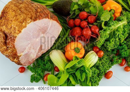 Hickory Smoked Whole Ham With Fresh Vegetables. Healthy Holiday Food.
