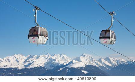 Ski Lift Above The Mountain Peaks