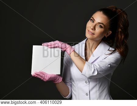 Young Smiling Brunette Woman Doctor Therapist Nurse In White Uniform And Protective Gloves Holding B