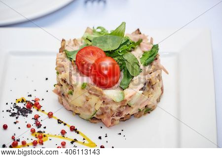 Russian Meat Salad Mayonnaise For Dinner. Mayonnaise Russian Meat Salad On White Plate Background. S