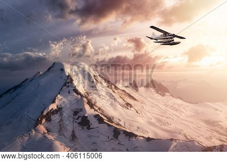 Airplane Flying Over A Dramatic Aerial Landscape View Of The Mountains. Sunset Sky. Adventure Compos