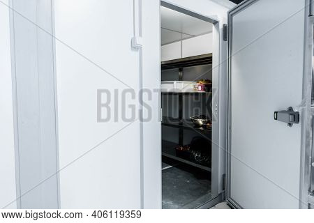 Refrigerator Room Door In Professional Kitchen In Restaurant