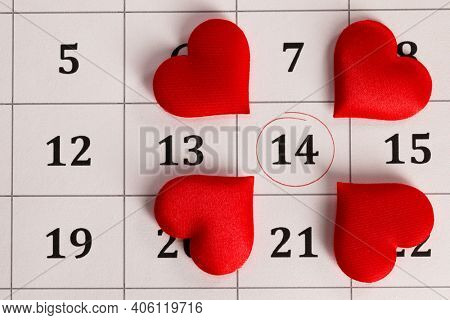 February 14 on the calendar, Valentine's day, red hearts on date