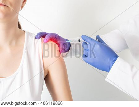 The Doctor Makes A Girl Patient An Injection Blockade In The Shoulder Joint To Relieve Muscle Tensio