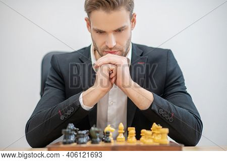Serious Involved Man In Front Of Chessboard