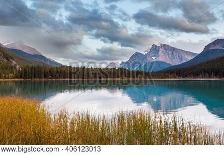 Serene scene by the mountain lake in Canada at sunset