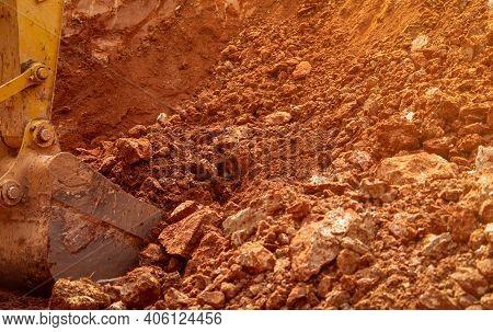 Backhoe Bucket Digging The Soil At Agriculture Farm To Make Pond. Crawler Excavator Digging At Shale