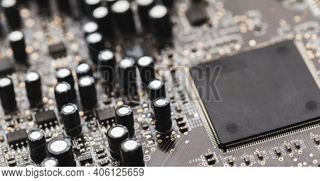 Gray Printed Circuit Board Macro Fragment With Microchip And Capacitors