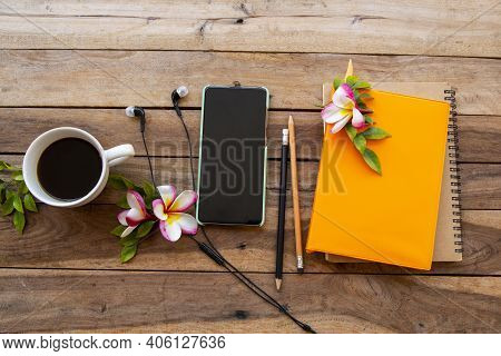 Notebook Diary ,mobile Phone And Hot Coffee Espresso For Business Work Of Lifestyle With Flowers Fra