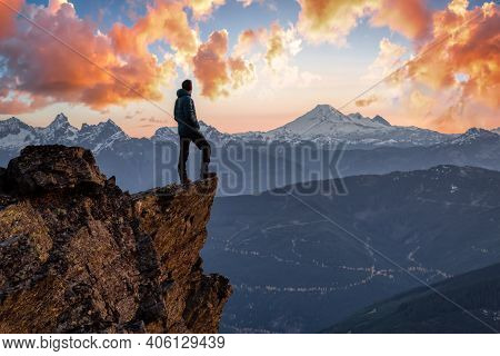 Adventurous Man Is Standing On Top Of The Mountain And Enjoying The Beautiful View. Taken On Top Of