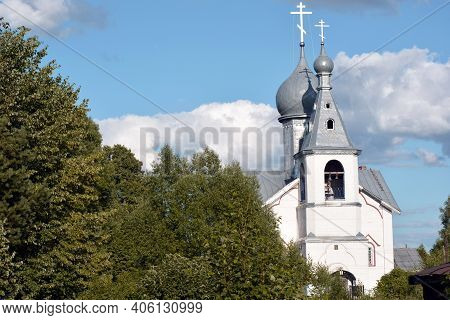 Small Village Church. White Stone Church In The Village. Temple Of Divine Services. A Building With