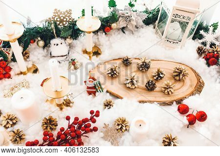 Festive Christmas Background With Santa Claus, Pine Cones, Red Berries And Candlesticks. Red And Gol