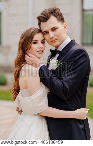 Beautiful, Gentle And Happy Bride And Groom. Man Gently Touches Womans Face