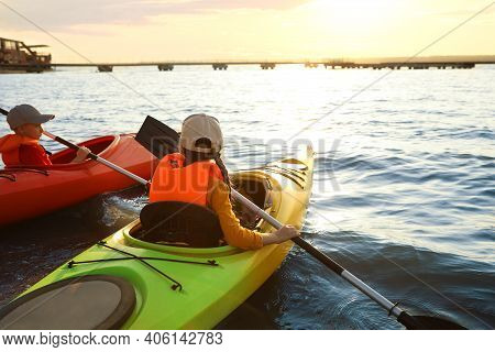 Little Children Kayaking On River. Summer Camp Activity