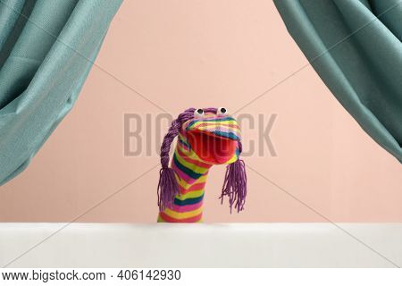 Creative Puppet Show On White Stage Indoors