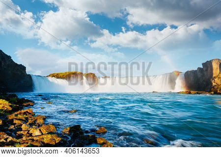 Captivating view of the grand Godafoss waterfall. Location place Skjalfandafljot river, Iceland, Europe. Vibrant photo wallpaper. Image of most popular world landmarks. Discover the world of beauty.