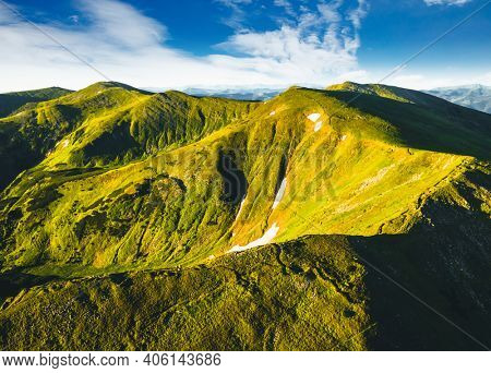 Fascinating summer scene of a green mountain range on a sunny day from a bird's eye view. Location place Carpathian, Ukraine, Europe. Aerial photography, drone shot. Discover the beauty of world.
