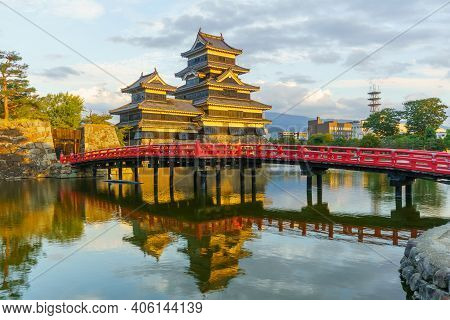 Sunset View Of The Matsumoto Castle (or Crow Castle) And Bridge, In Matsumoto, Japan