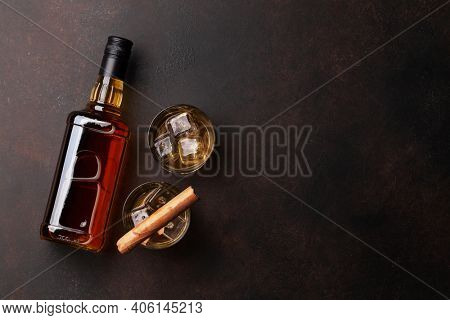 Scotch whiskey bottle, glasses and cigar. With copy space. Top view flat lay