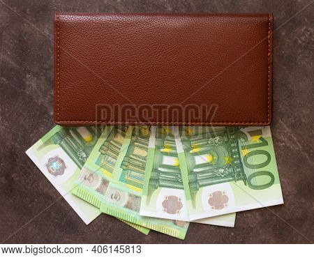 European Currency Money Euro In A Brown Leather Wallet On A Dark Background, Copy Space For Text